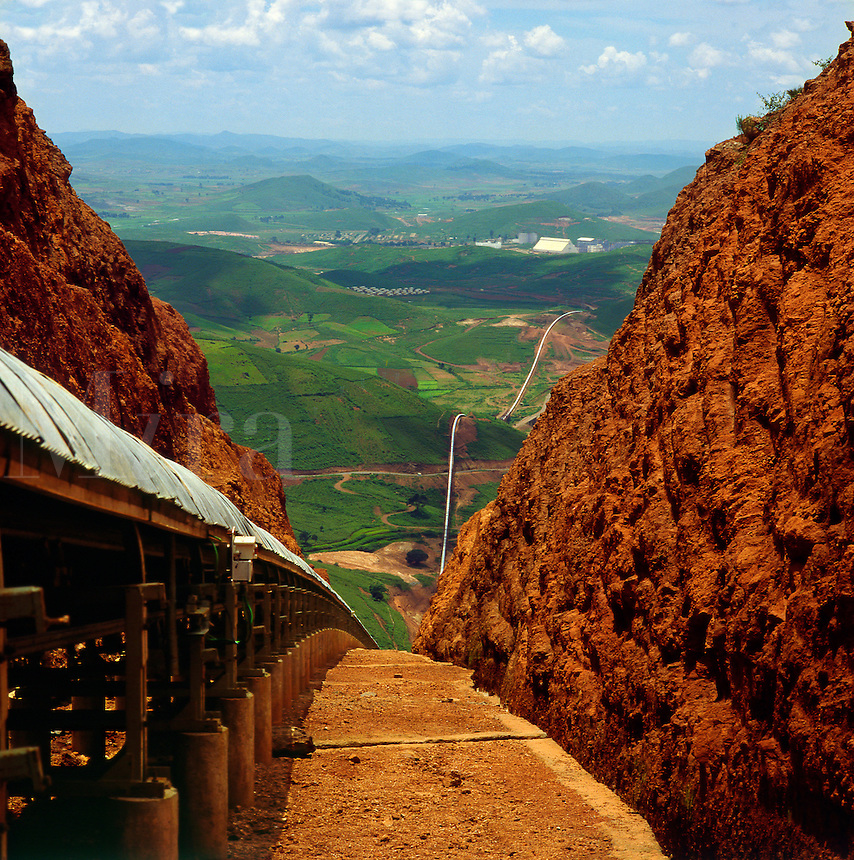 .Long distance, approximately 25 Km, belt conveyor carrying bauxite from the mine to the process plant.  Orissa State, India..