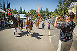 Independence Day celebration Main Street, Mokelumne Hill, California..House mounted color guard leading the aprade