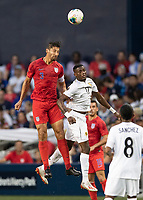 KANSAS CITY, KS - JUNE 26: Omar Gonzalez #3 and Jose Fajardo #17 go up for a header during a game between Panama and USMNT at Children's Mercy Park on June 26, 2019 in Kansas City, Kansas.
