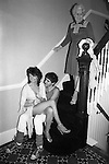 """Grandmother comes down the stairs at a so called """"Hot Chocolate"""" party named after the pop group of the time. Suburban middle class fancy dress party. Wimbledon SW19. England. 1983."""