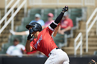 Amado Nunez (18) of the Piedmont Boll Weevils follows through on his swing against the Greensboro Grasshoppers at Kannapolis Intimidators Stadium on June 16, 2019 in Kannapolis, North Carolina. The Grasshoppers defeated the Boll Weevils 5-2. (Brian Westerholt/Four Seam Images)