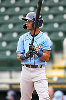 FCL Rays Jelfry Marte (76) bats during a game against the FCL Pirates Gold on July 26, 2021 at LECOM Park in Bradenton, Florida. (Mike Janes/Four Seam Images)