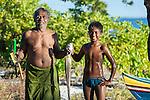 Father and sons catch of the day. Christmas Island (Kiritimati), Kiribati
