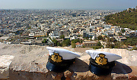 Two hats that belong to Italian Navy sailors sit on the wall at the Acropolis overlooking Athens, Greece Thursday August 12, 2004. The historic Acropolis is visible from most of the city. (Photo by Alan Greth)