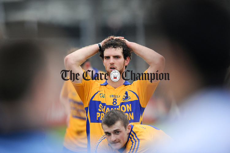 Sixmilebridge's Kevin Lynch and Seadhna Morey look on in disappointment as the Na Piarsaigh players head up for the cup following the the Munster Club Championship final defeat at Cusack park. Photograph by John Kelly.