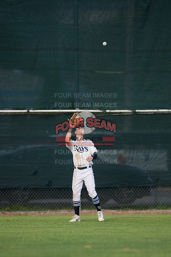 Princeton Rays center fielder Grant Witherspoon (5) settles under a fly ball during the first game of a doubleheader against the Johnson City Cardinals on August 17, 2018 at Hunnicutt Field in Princeton, Virginia.  Johnson City defeated Princeton 6-4.  (Mike Janes/Four Seam Images)