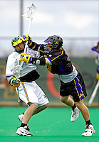 14 April 2007: University of Albany Great Danes' Mike Ammann, a Junior from Putnam Valley, NY, checks University of Vermont Catamount Pete Hein, a Senior from Greenwood Village, CO, during game action at Moulton Winder Field, in Burlington, Vermont. The Great Danes defeated the Catamounts 14-7...Mandatory Photo Credit: Ed Wolfstein Photo