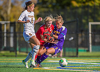 29 September 2013: University of Vermont Catamount Goalkeeper Morgan Nichols, a Senior from Concord, CA, comes out to make a save against Stony Brook University Seawolves Forward/Midfielder Leah Yurko (15), a Freshman from Cumberland, MD, as Forward/Defender Haley Marks (6), a Senior from Penfield, NY, clears the ball at Virtue Field in Burlington, Vermont. The Lady Cats fell to the visiting Seawolves 2-1 in America East play. Mandatory Credit: Ed Wolfstein Photo *** RAW (NEF) Image File Available ***