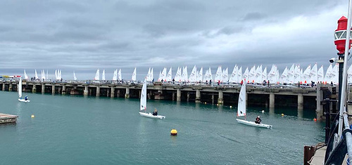 A fleet of 240 boys and girls rigged and ready to sail from the Carlisle Pier at Dun Laoghaire Harbour. Competitors from 31 countries are contesting theLaser ILCA 4.7 Youth World Championships at Dun Laoghaire Harbour this week