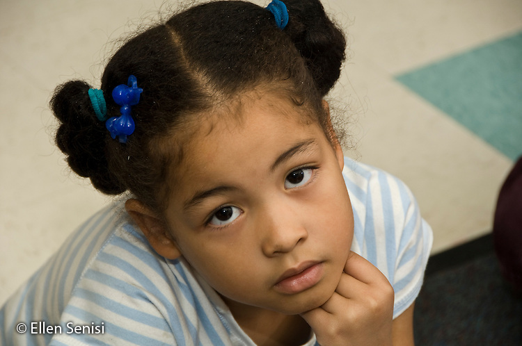 MR / College Park, Maryland.Center for Young Children, laboratory school within the College of Education at the University of Maryland. Full day developmental program of early childhood education for children of faculty, staff, and students at the university..Portrait of girl (6, African American) in classroom..MR: Har17.© Ellen B. Senisi