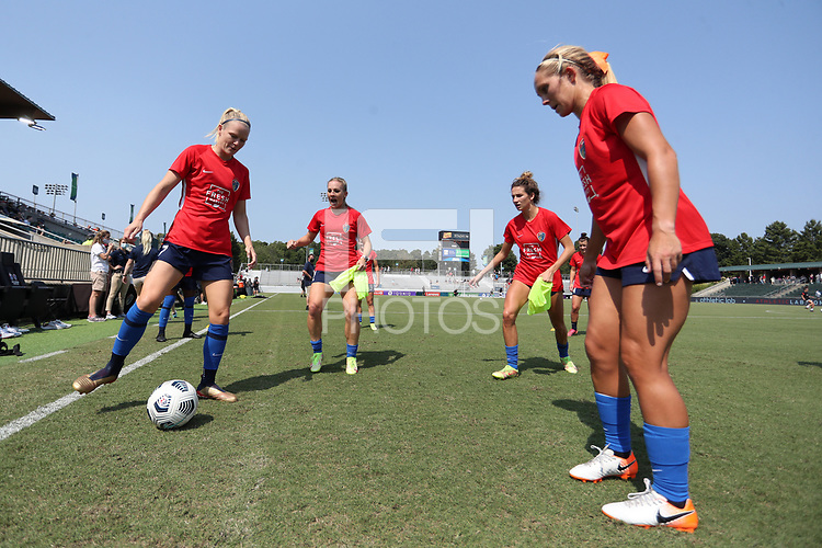 CARY, NC - SEPTEMBER 12: Diane Caldwell #7, Amy Rodriguez #12, Ryan Williams #13, and Brittany Ratcliffe #27 of the North Carolina Courage play a small sided game before a game between Portland Thorns FC and North Carolina Courage at Sahlen's Stadium at WakeMed Soccer Park on September 12, 2021 in Cary, North Carolina.