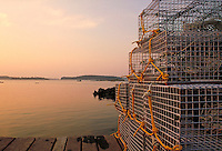 Modern lobster traps on pier at sunrise. Maine, New England.