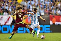 Foxborough, MA - Saturday June 18, 2016: Rolf Feltscher, Lionel Messi during a Copa America Centenario quarterfinal match between Argentina (ARG) and Venezuela (VEN)  at Gillette Stadium.