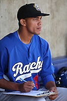 Yaisel Sierra (19) of the Rancho Cucamonga Quakes charts pitches in the dugout during a game against the High Desert Mavericks at Heritage Field on May 8, 2016 in Adelanto, California. Rancho Cucamonga defeated High Desert, 11-5. (Larry Goren/Four Seam Images)
