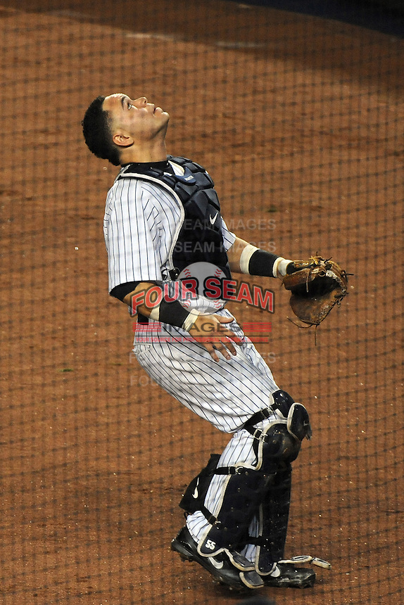New York Yankees catcher Russell Martin #55 during ALDS game #5 against the Detroit Tigers at Yankee Stadium on October 06, 2011 in Bronx, NY.  Detroit defeated New York 3-2 to take the series 3 games to 2 games.  Tomasso DeRosa/Four Seam Images