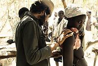 Infirmary in Sara, Guinea-Bissau - Cuban doctor Antonio checking up heartbeat - 1974