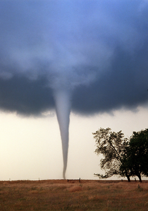 A majestic slender tornado spins out of a supercell thunderstorm near Attica Kansas on May 29th, 2004.
