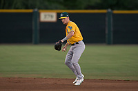 AZL Athletics second baseman Nick Ward (4) prepares to make a throw to first base during an Arizona League game against the AZL Giants Black at the San Francisco Giants Training Complex on June 19, 2018 in Scottsdale, Arizona. AZL Athletics defeated AZL Giants Black 8-3. (Zachary Lucy/Four Seam Images)