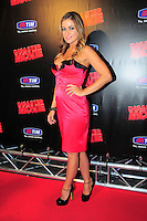 """CARMEN ELECTRA .Italian Film Premiere for """"Disaster Movie"""" in Rome, Italy, October 8th 2008..full length pink dress black shoes ankle strap trim ruffle buttons strapless hand on hip.CAP/CAV.©Luca Cavallari/Capital Pictures"""