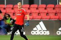 WASHINGTON, DC - MAY 13: Jon Kempin #21 of D.C. United warming up during a game between Chicago Fire FC and D.C. United at Audi FIeld on May 13, 2021 in Washington, DC.