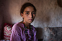 """Morocco - Ouarzazate - Fatima Zahra el Hassani, 14, sits at her parent's house. Thanks to her  expressive eyes and beautiful features, Fatima Zahra el Hassani is one of the most sough-after young actors in Ouarzazate. Despite being only 11, she has already featured in several TV series such as Game of Thrones, Prison Break and King Tut, playing everything from the poor Afghan girl in American war movies to the young queen. Coming from a destitute family, el Hassani dreams of becoming a movie star. """"I don't act as an extra anymore"""" she explains. """"My mother allows me to skip school only for important roles."""""""