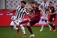 Weston McKennie of Juventus FC and Rolando Mandragora of Torino Calcio compete for the ball during the Serie A 2021/2022 football match between Torino FC and Juventus FC at Stadio Olimpico Grande Torino in Turin (Italy), October 2nd, 2021. Photo Federico Tardito / Insidefoto