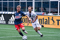 FOXBOROUGH, MA - JULY 4: Pierre Cacet #44 of the New England Revolution II and Marios Lomis #9 of Greenville Triumph SC battle for the ball during a game between Greenville Triumph SC and New England Revolution II at Gillette Stadium on July 4, 2021 in Foxborough, Massachusetts.