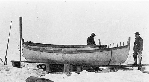 Harry McNish at the vital task of converting the lifeboat James Caird into a sailable seagoing propositions on Elephant Island