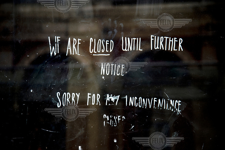 A sign on the window of a restaurant/bar in Clerkenwell that reads: 'We are closed until further notice'.