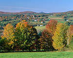 Caledonia County, VT<br /> Farm in a valley of green meadows and autumn colored hardwood forests near Peacham