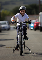 Pictured: Alan Gifford on his bicycle. Friday 18 August 2017<br /> Re: 11 year old Alan Gifford who has two prosthetic arms, Loughor near Swansea, Wales, UK.