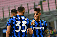 Inter Milan's Lautaro Martinez, right, celebrates with his teammate Danilo D'Ambrosio after scoring on a penalty kick during the Italian Serie A football match between Inter Milan and Sampdoria at Milan's Giuseppe Meazza stadium, May 8, 2021.<br /> UPDATE IMAGES PRESS/Isabella Bonotto