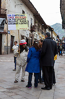 Peru, Cusco.  Demonstrator with Political Sign Critical of the President.