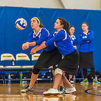 18 October 2015: Yeshiva University Maccabee Right Side and Outside Hitter Ilana Leggiere (left), a Sophomore from New York, NY, with Setter and Defensive Specialist Emily Rohan, a Senior from Dallas, TX, both bump during game action against the Sage College Gators, at the Peter Sharp Center, College of Mount Saint Vincent, in Riverdale, NY. The Gators defeated the Maccabees 3-0 in the NCAA Division III Women's Volleyball Skyline matchup. Mandatory Credit: Ed Wolfstein Photo *** RAW (NEF) Image File Available ***