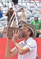 BOGOTÁ -COLOMBIA. 21-07-2013. Ivo Karlovic (CRO) besa el trofeo como campeón del ATP Claro Open Colombia 2013 tras vencer a Alejandro Falla (COL) hoy en el Centro de Alto Rendimiento en Bogota./ Ivo Karlovic (CRO) kisses the trophy as champion of ATP Claro Open Colombia 2013 after defeating to Alejandro Falla (COL) today in the final at Centro de Alto Rendimiento in Bogota city. Photo: VizzorImage / Str