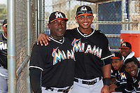 GCL Marlins manager Julio Bruno (36) and Angel Reyes (17) in the dugout before the second game of a doubleheader against the GCL Mets on July 24, 2015 at the St. Lucie Sports Complex in St. Lucie, Florida.  GCL Marlins defeated the GCL Mets 5-4.  (Mike Janes/Four Seam Images)