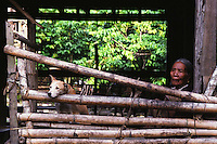 An old woman and her dog. Photo taken in the Philippine Cordillera at the northeastern part of main island of Luzon, Philippines. Malibcong, Abra. August, 1999