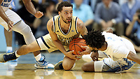 CHAPEL HILL, NC - JANUARY 4: Jose Alvarado #10 of Georgia Tech and Leaky Black #1 of the University of North Carolina challenge for a loose ball during a game between Georgia Tech and North Carolina at Dean E. Smith Center on January 4, 2020 in Chapel Hill, North Carolina.