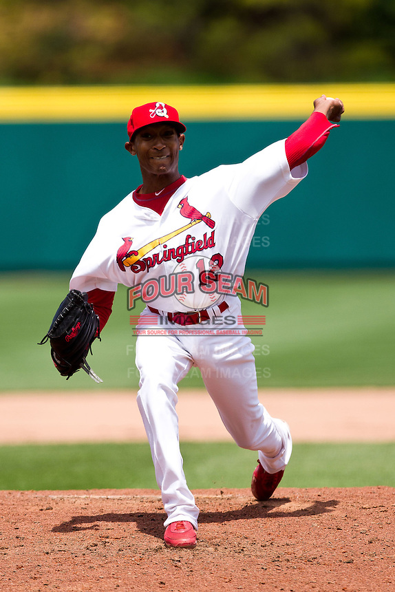 Sam Freeman (12) of the Springfield Cardinals delivers a pitch during a game against the Arkansas Travelers at Hammons Field on May 8, 2012 in Springfield, Missouri. (David Welker/ Four Seam Images).