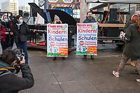 """Anlaesslich des ertsne Jahrestag der Coronamassnahmen der Bundesregierung protestierten etwas ueber 200 Menschen auf dem Berliner Alexanderplatz gegen die Politik der Bundesregierung. Sie forderten ein Ende der Maskenregelungen und Einschraenkungen in oeffentlichen Leben. Die Demonstranten riefen """"Liebe, Freiheit, Keine Diktatur"""" und """"Wahrheit macht Frei"""".<br /> Der Veranstalter, der Youtube-Schlagerstar Bjoern Winter alias Bjoern Banane, hatte 1000 Menschen zu der Kundgebung erwartet.<br /> 13.3.2021, Berlin<br /> Copyright: Christian-Ditsch.de"""