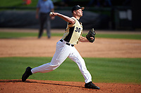 UCF Knights relief pitcher Campbell Scholl (30) delivers a pitch during a game against the Siena Saints on February 21, 2016 at Jay Bergman Field in Orlando, Florida.  UCF defeated Siena 11-2.  (Mike Janes/Four Seam Images)