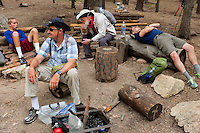 Photo story of Philmont Scout Ranch in Cimarron, New Mexico, taken during a Boy Scout Troop backpack trip in the summer of 2013. Photo is part of a comprehensive picture package which shows in-depth photography of a BSA Ventures crew on a trek.  In this photo  adult advisors and youth take a break near a fire circle after climbing the natural rock surfaces at the  Cimarroncito Camp in the backcountry at Philmont Scout Ranch.   <br /> <br /> <br /> The  Photo by travel photograph: PatrickschneiderPhoto.com
