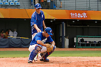17 August 2007: Assistant Coach Boris Rothermundt stands behind catcher Boris Marche as he practices during the Good Luck Beijing International baseball tournament (olympic test event) at the Wukesong Baseball Field in Beijing, China.