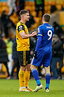 7th February 2021; Molineux Stadium, Wolverhampton, West Midlands, England; English Premier League Football, Wolverhampton Wanderers versus Leicester City; Leander Dendoncker of Wolverhampton Wanderers and Jamie Vardy of Leicester City shake hands at the end of the game
