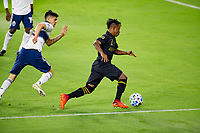 LOS ANGELES, CA - SEPTEMBER 23: Latif Blessing #7 of the LAFC dribbles the ball during a game between Vancouver Whitecaps and Los Angeles FC at Banc of California Stadium on September 23, 2020 in Los Angeles, California.