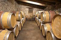 Oak barrique barrels with aging red wine Chateau Belingard Bergerac Dordogne France