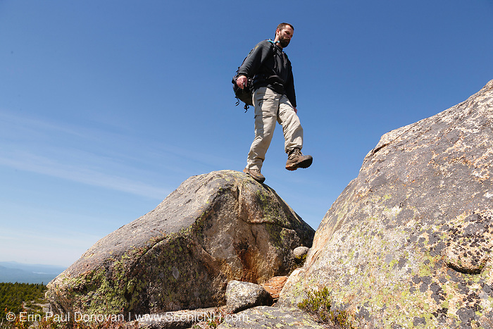 A hiker on Middle Sister Trail near Mount Chocorua during the spring months. Located in the White Mountains, New Hampshire USA