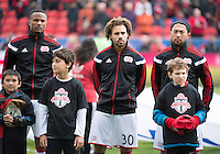 Toronto, Ontario - May 3, 2014: New England Revolution players stand for the national anthems during the opening ceremonies in a game between the New England Revolution and Toronto FC at BMO Field.<br /> The New England Revolution won 2-1.