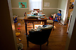My son, age three, is momentarily stunned by the mess he and his baby brother have created.