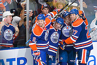 EDMONTON, CANADA - OCTOBER 7:  (L-R) Jim Vandermeer #2, Sam Gagner #89, Ales Hemsky #83 and Dustin Penner #27 of the Edmonton Oilers celebrate a third period goal against the Calgary Flames at Rexall Place on October 7, 2010 in Edmonton, Alberta, Canada.  The Oilers beat the Flames 4-0.  (Photo by Andy Devlin/NHLI via Getty Images) *** LOCAL CAPTION *** Jim Vandermeer;Sam Gagner;Ales Hemsky;Dustin Penner